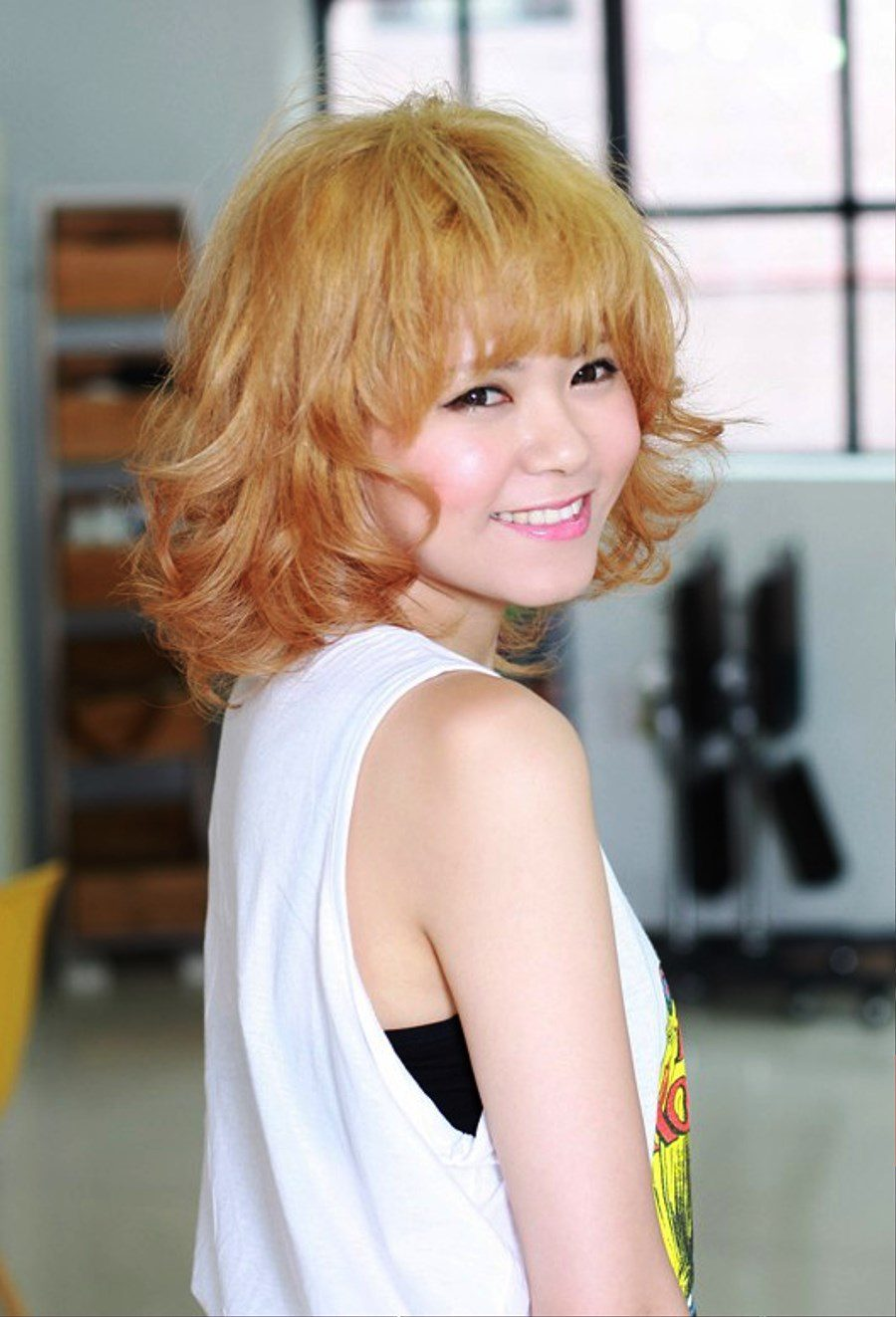 Short Curly Hairstyle With Cute Bangs Pictures