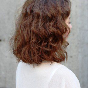 Short Red Curly Hairstyle