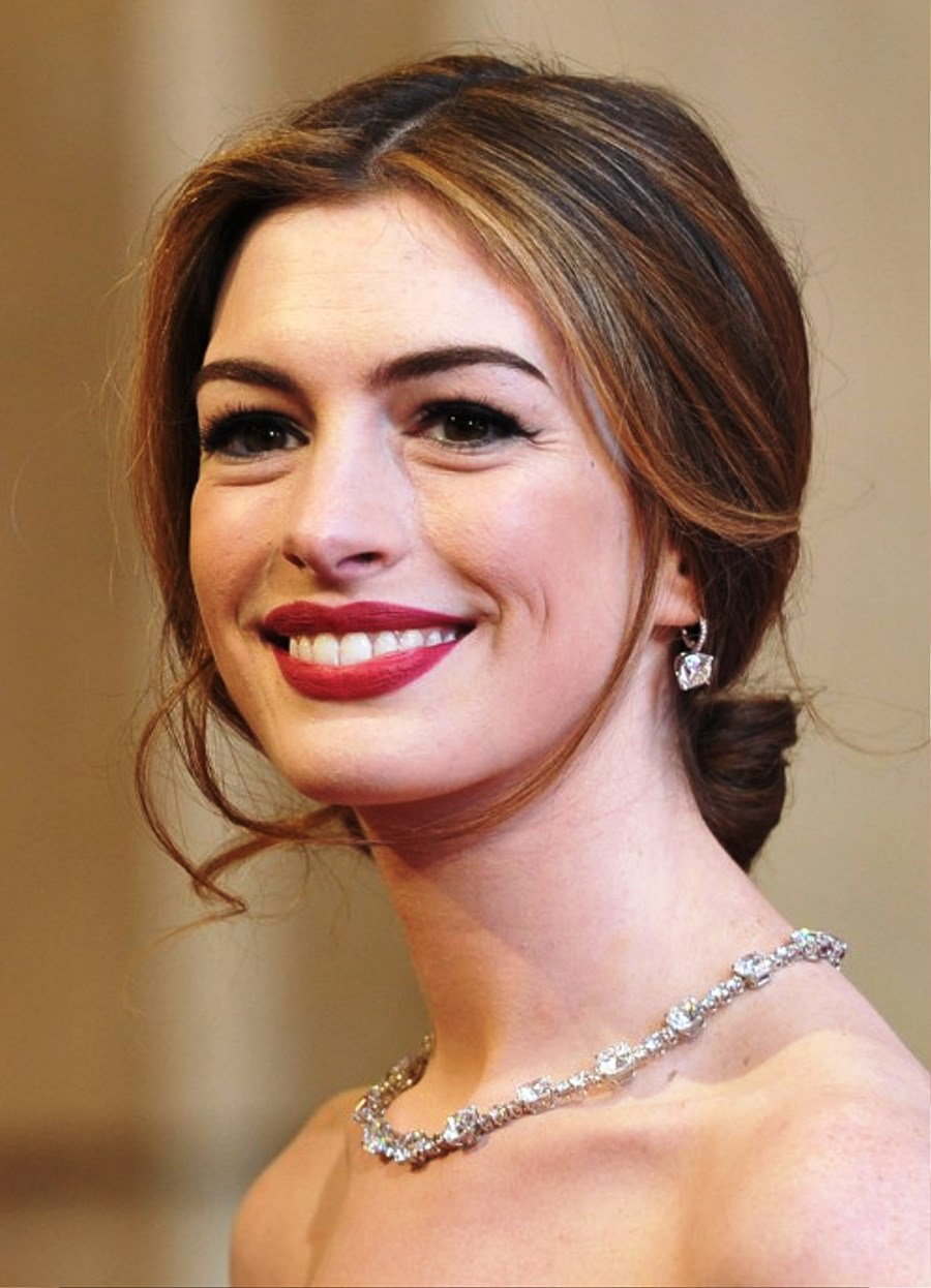Pictures Of Anne Hathaway Center Part Loose Bun Updo