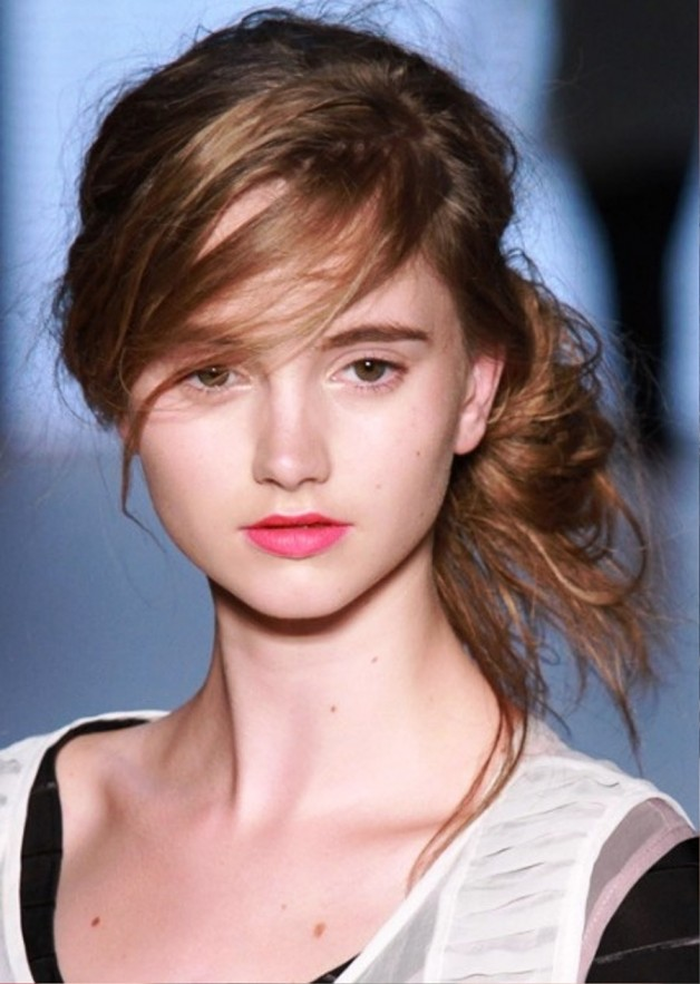 Cute Messy Bun Hairstyle With Bangs