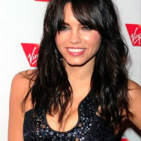 Long Black Hairstyle With Soft Curls And Wispy Bangs