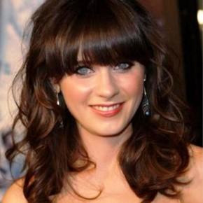 Medium Wavy Hairstyle With Bangs