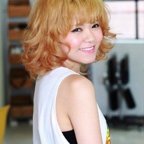 Short Curly Hairstyle With Cute Bangs