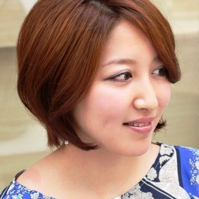 Trendy Short Auburn Haircut For Women