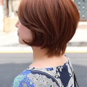 Side View Of Short Auburn Haircut For Women