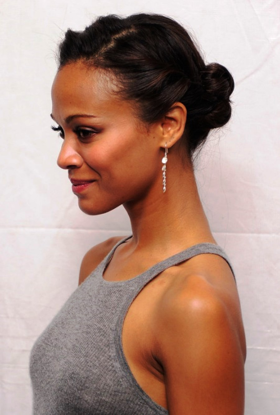 Pictures Of Zoe Saldana Cute Casual Updo Hairstyle